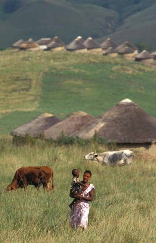 Zulu woman with children in village in KwaMkhize, in KwaZulu-Natal