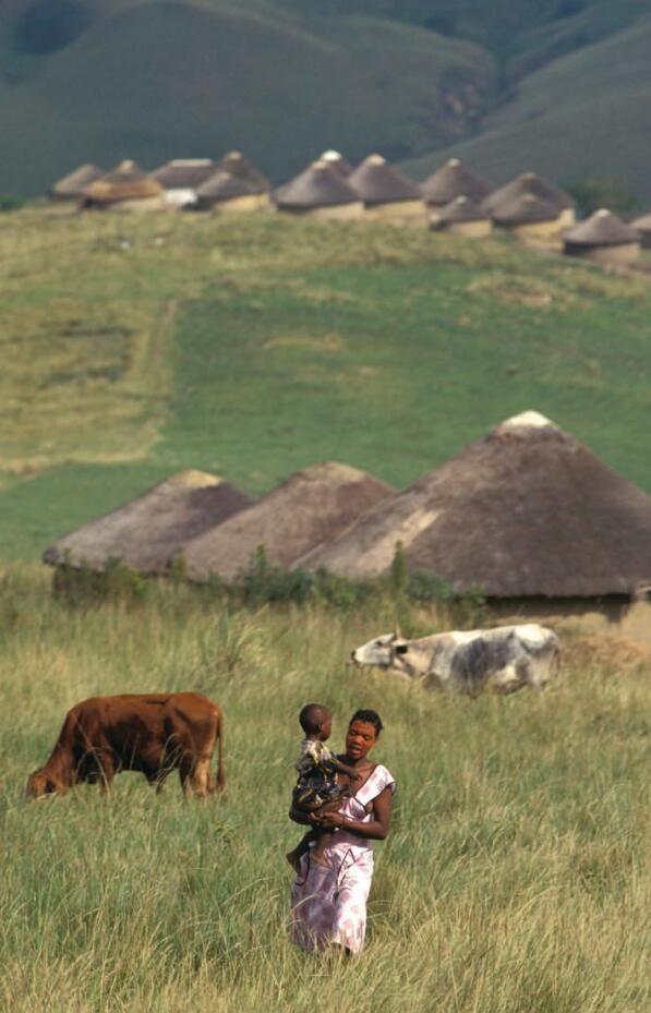 Zulu woman with children in village in KwaMkhize, in KwaZulu-Natal